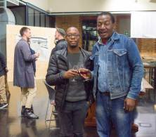 Masimba Sasa and a friend viewing the preliminary sketches